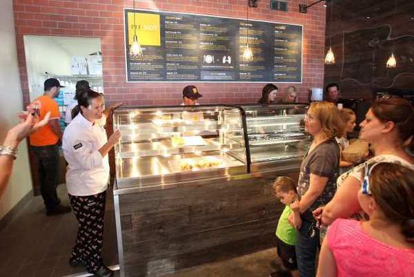 "Head chef Samantha Boxer, far left, greets guests during a soft opening of Pie-Not, which dubs itself an ""Aussie-style bakery."""