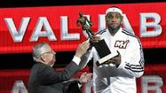Heat forward LeBron James accepts his 2103 MVP award from NBA Commissioner David Stern prior to Monday's game against the Bulls. (Michael Laughlin, Sun Sentinel)