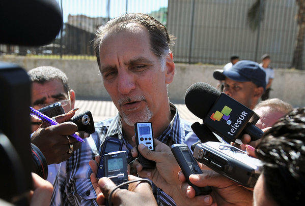 "Rene Gonzalez, one of the ""Cuban Five"" group convicted of espionage in the United States, speaks with journalists outside the U.S. Interest Section in Havana."