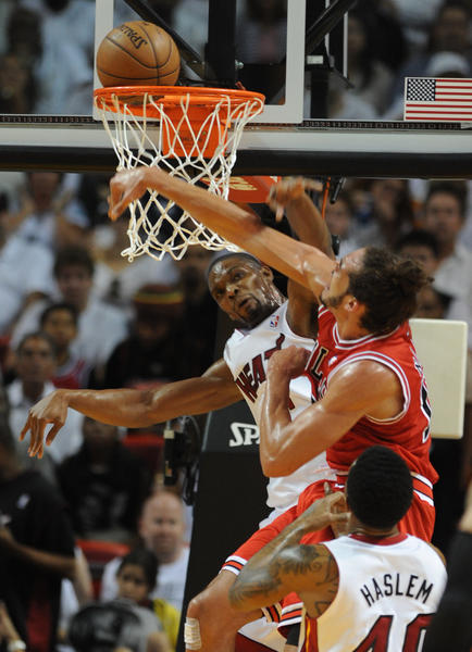 Chris Bosh of the Miami Heat cant stop the Chicago Bulls Joakim Noah during the first quarter of the Eastern Conference semifinal game one, Monday May 6, 2013, at the AmericanAirlines Arena in Miami..Joe Cavaretta, SunSentinel (c)2013.....