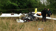 Federal investigators began examining Monday the wreckage of a two-seater, home-built airplane that crashed Sunday in Virginia, killing a man from Davidsonville and his son from Westminster, the father of 10 children.