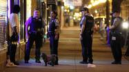 Flashlights in hand, the five rookie Chicago cops were walking along a darkened stretch of the gang-infested South Side neighborhood on a recent night when their radios crackled with a call of a battery in progress.