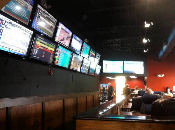 Bolingbrook's first off-track betting facility opened last week at McQ's Sports Bar & Dome at 730 N. Bolingbrook Dr.