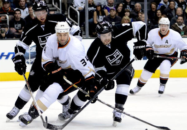 Anaheim Ducks' Daniel Winnik, left, and L.A. Kings' Drew Doughty battle for the puck.