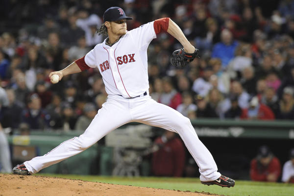 Boston Red Sox starting pitcher Clay Buchholz (11) pitches during the fourth inning against the Minnesota Twins at Fenway Park.