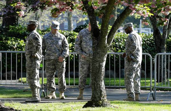 Soldiers stand guard outside a building at Joint Base Lewis-McChord in Washington state. A court-martial is underway that will help determine the sentence for Army Sgt. John Russell, who killed five fellow service members at a mental health clinic in Iraq.