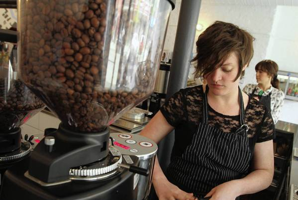 Barista Kelly Mattimoe prepares an order at the new Intelligentsia Coffee shop in Logan Square.