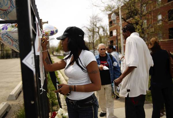 Tracy Smith was among those who visited a makeshift memorial Monday for Tywon Jones, who was fatally shot by police in the 1300 block of South Independence Boulevard on Sunday.