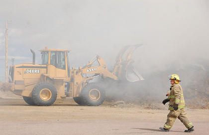 Aberdeen Fire and Rescue and Aberdeen Rural Fire Department helped douse a grass fire Monday at a dropsite for the Brown County Landfill near the Brown County Fairgrounds.