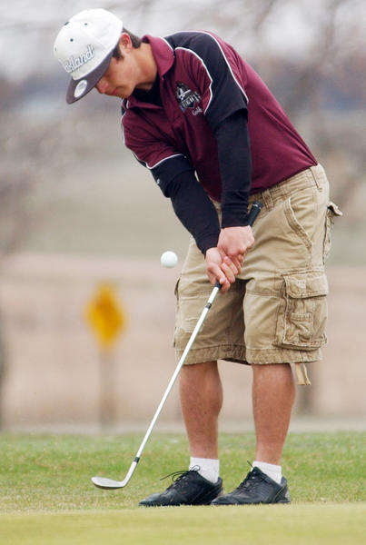 Matt Rohrbach of Aberdeen Christian chips onto the green at he Pre-Region golf meet Monday in Watertown. Watertown Public Opinion Photo by Rich Remmers