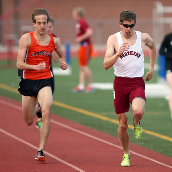 Northern State University's Mark Gilkerson, right, races Jamestown's Spencer Kamoni, left as they run for the finish in the second heat of the men's 800 meter run Friday at the NSU Open track meet at Swisher Field. American News File Photo by John Davis