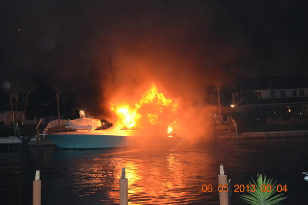 No injuries were reported when this boat caught fire Monday night behind a Lighthouse Point home along the 3000 block of Northeast 43rd Street.