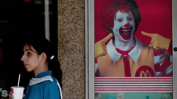 A schoolgirl leaves McDonald's outlet in New Delhi, India, in a 2011 file photo.