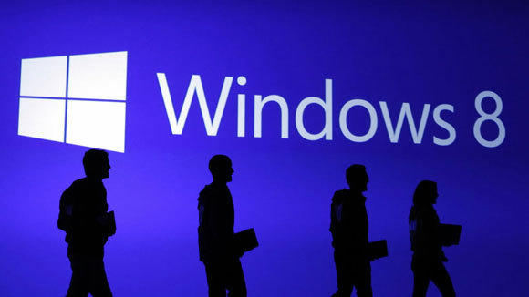 Guests are silhouetted at the launch event of the Windows 8 operating system in New York in October.
