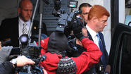 Penn State assistant football coach Mike McQueary was placed on leave because he received death threats after Jerry Sandusky was charged with molesting children, the university says in a response to McQueary's suit claiming he was fired for cooperating in the investigation of Sandusky.