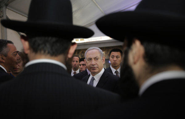 Israeli Prime Minister Benjamin Netanyahu, center, meets rabbis as he visits the Shanghai Jewish Refugees Museum at former site of Ohel Moshe Synagogue in China.