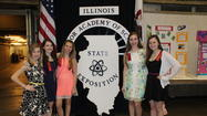 "Five St. Joseph School of Downers Grove 8th Graders participated in the annual Illinois Junior Academy of Science's State Exposition in Champaign over the May 3-4 weekend, competing against other 8th graders across Illinois. Laura Harris, Audrey Roth and Jacqueline Ruf earned Silver Award honors for their ""Potato Power"" project, which measured electrical current in various types of potatoes – sweet potatoes measured the highest on the girls' voltmeter. Elizabeth Drennan and Maggie White won a Gold Award for ""Walking on Thin Ice"" and learned an important fact: ""We discovered that calcium chloride is an excellent alternative to road salt because it's more efficient at melting ice and is also more environmentally safe."""