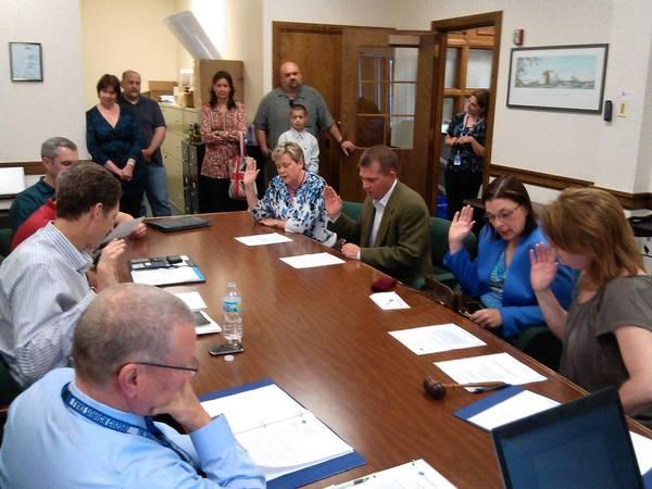 Lake Zurich Community Unit School District 95 board members are sworn in.