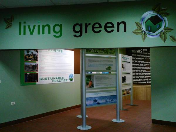 "The new ""Living Green"" exhibit opened in the downtown Arlington Heights train station, filling an empty space left by a McDonalds."