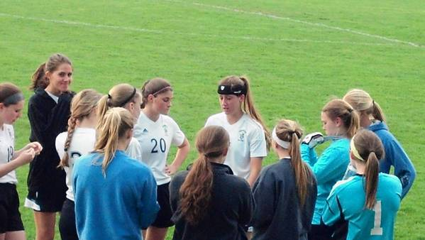 Cali Pyzdowski, center with blue headband, is helping Fenwick in its quest for a state championship.