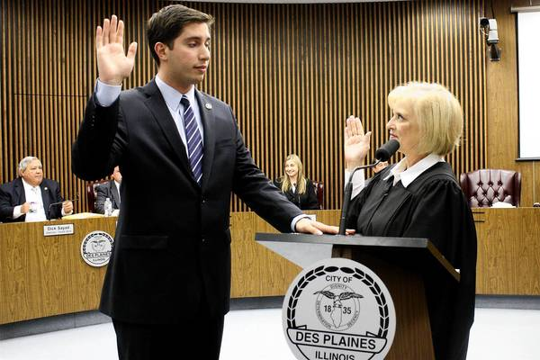 New Des Plaines Mayor Matt Bogusz receives the oath of office from Judge Aurelia Pucinski at the May 6 City Council meeting.