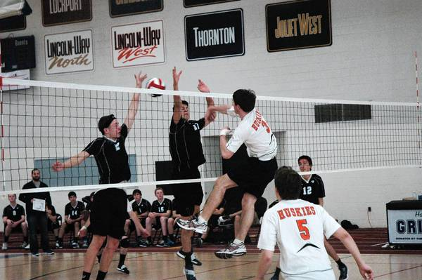The Naperville North boys volleyball team takes on Downers Grove South in their final game of the Lincoln-Way East Invitational on May 3-4.