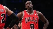 MIAMI -- Luol Deng remained in Chicago on Tuesday and coach Tom Thibodeau said the Bulls are still mulling what the best plan is for the All-Star forward, who isn't expected to play in Wednesday's' Game 2.