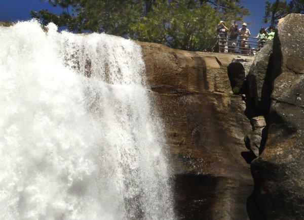 Yosemite National Park visitors snap photos from behind the guard rails at Vernal Fall.