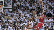 Bulls Joakim Noah shoots over Miami Heat Chris Bosh during their NBA Eastern Conference semi-final basketball playoff in Miami