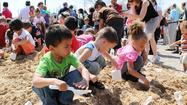 AURORA – Hundreds of people attended a May 1 groundbreaking ceremony for the Aurora Public Library's new Main Library at the southwest corner of River and Benton streets in downtown Aurora.