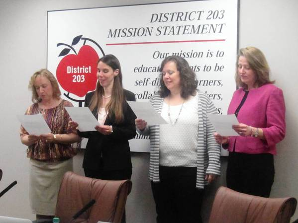 Naperville Unit District 203 gives the oath of office to new school board members Donna Wandke and Kristin Fitzgerald along with re-elected members Susan Crotty and Jackie Romberg.