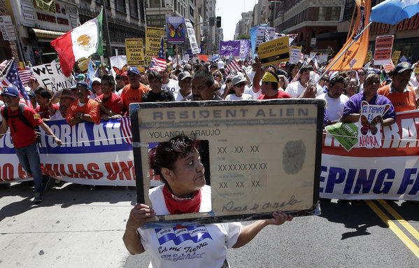 Marchers at a May Day rally this month show support for comprehensive immigration reform.