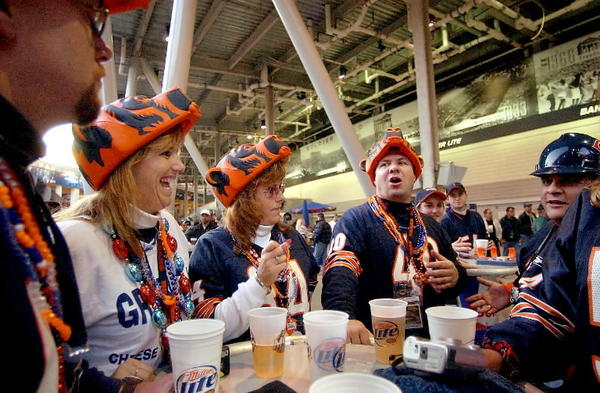 Bear fans, from left to right, Bill Pitner, Laurie Knowles, Dana Pitner, Bob Niemet and an unidentified man wearing hard hat, hang out and drink beer at the south endzone concession area at the newly renovated Soldier Field in 2003.