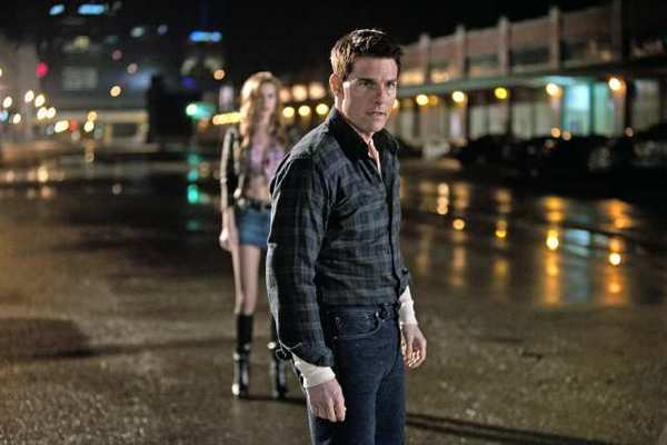 Tom Cruise (front) is Reacher and Alexia Fast (rear) is Sandy in JACK REACHER, from Paramount Pictures and Skydance Productions.