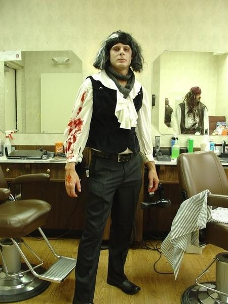Daniel Wells, a real barber, poses as the fictional demon barber Sweeney Todd on Halloween, 2011. Wells is opening a gentleman's barber shop on The Avenue in Hampden.