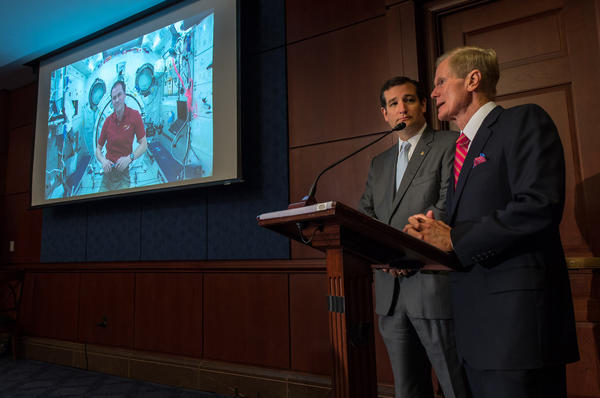 Sens. Ted Cruz (R-Texas), left, and, Sen. Bill Nelson (D-Fla.), talk, via a live downlink, to NASA astronaut Tom Marshburn aboard the International Space Station.