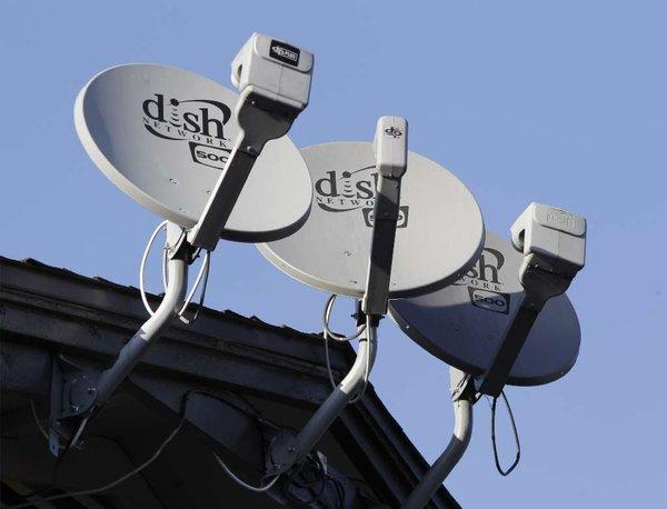Dish antennas outside California apartment complex