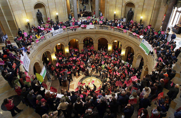Supporters and opponents of a bill to legalize gay marriage in Minnesota gather in the state Capitol rotunda in St. Paul, where the battle over gay marriage shifts after Delaware's vote Tuesday.