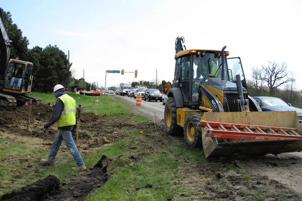 Traffic backs up on Willow Road, near Waukegan Road, as workers move a gas main. The $27 million, two-year project to widen Willow Road to four lanes is just beginning.