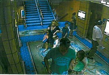 This Disney Fantasy surveillance photo shows the Lykken family on the Deck 11 elevator lobby.