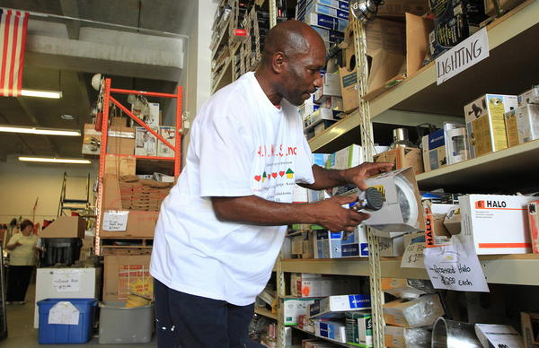 George Brown with H.O.M.E.S Inc, a Non-Profit organization that provides affordable housing for young people transitioning out of the foster care system, picks out items at Morning Day Community Solutions.