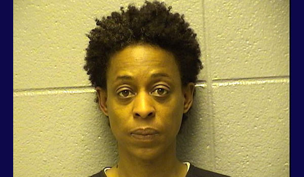 Former Ald. Sharon Denise Dixon, 50, charged with having a loaded, unregistered gun at the Ogden District Police Station.