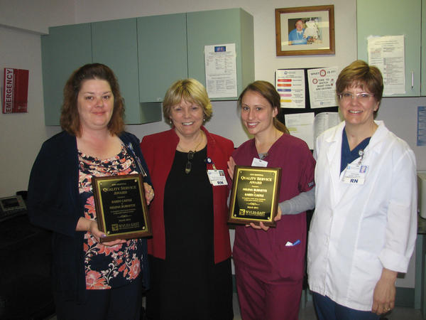 From left, Karen Castle, one of City Hospital's March Quality Service Award winners; Donna Clews, vice president of patient-care services; Helena Burnette, one of City Hospital's March Quality Service Award winners; and Kathleen Kerstetter, fifth-floor nurse director.
