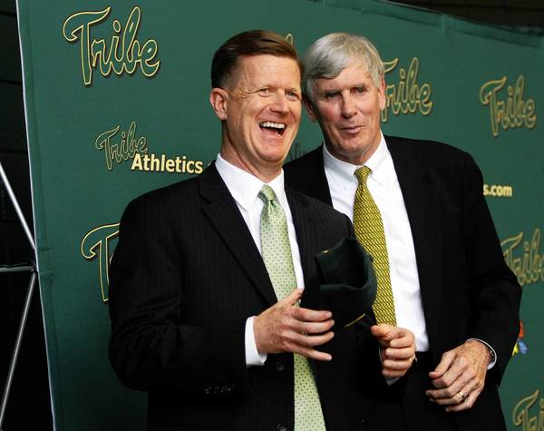 Newly named William and Mary women's basketball coach Ed Swanson, left, jokes with athletic director Terry Driscoll following a news conference on Tuesday in Williamsburg.