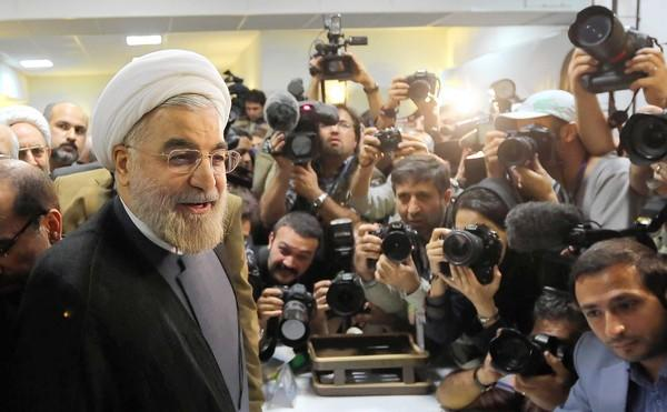 Former chief Iranian nuclear negotiator Hassan Rowhani arrives at the Interior Ministry in Tehran to register for the June 14 presidential election.