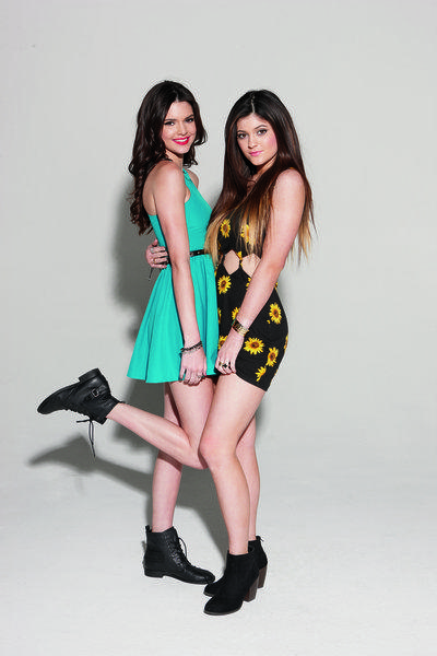Kendall, left, and Kylie Jenner wear a couple of the outfits in their Kendall & Kylie Collection for PacSun.