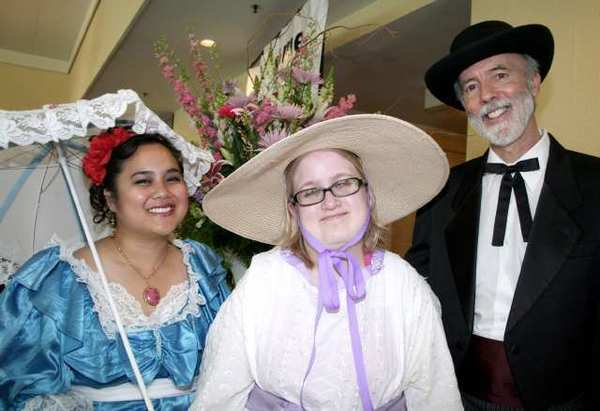 Greeting Derby Day guests are, from left, former Glendale Assn. for the Retarded former staff member Beverly Mondok-Thomas, Assn. client Casey Lavely and Assn. consultant David Cain.
