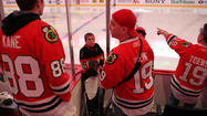 Hawks fans wait for the team to take the ice.