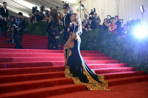 Beyonce, honorary chairwoman, arrives at the Metropolitan Museum of Art's Costume Institute Gala on Monday night wearing a Givenchy gown with sweeping train.