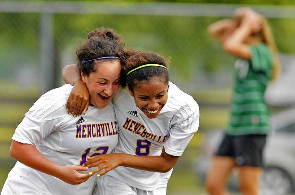 Jonathon Gruenke/Daily Press Photo Menchville's Nelia Perez, center, and Evelyn Aloupos, left, celebrate after Perez's goal during Tuesday's game against Kecoughtan.